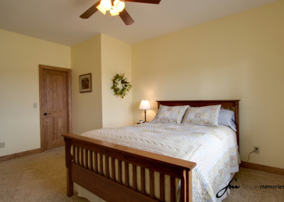 Bedroom with Wood Headboard and Footboard