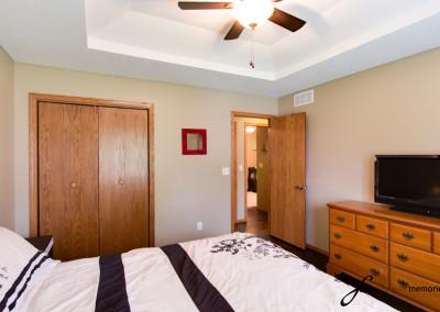 Bedroom, Closet door, TV and door to the hallway