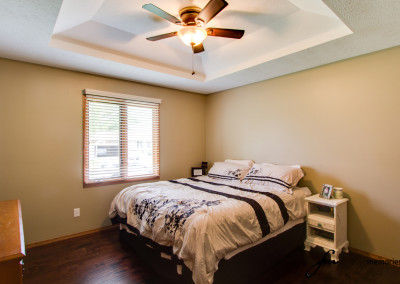 Bedroom with white and brown comforter