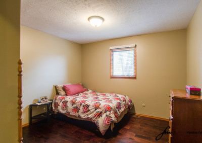 Bedroom with pink comforter
