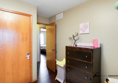 Nursery with closet door and dresser