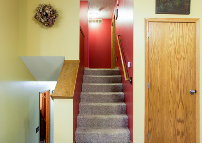 Stairs and the red hallway