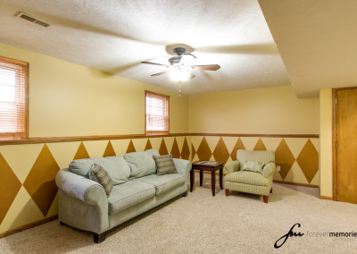 Family room with fan and couch