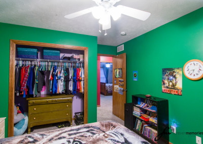 Bedroom with green walls and closet